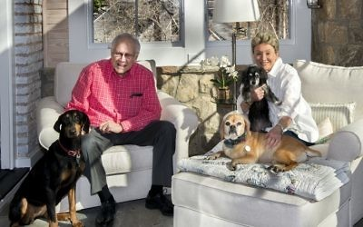Ron and Judy Goldstein relax in the art studio/sunroom with treasured pups Kirby, a puggle, Carly, a rescue of unknown lineage, and Ella (Judy's name for her) or Della (Ron's name), a Doberman rescue. (Photo by Duane Stork)
