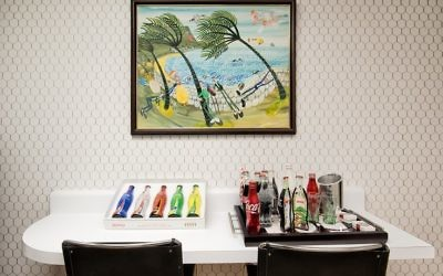 Ron Goldstein donated most of his Coca-Cola memorabilia to the Dental College of Georgia in Augusta for its Ronald E. Goldstein Learning Center. The palm trees above the Coke bottles represent windy Cape Town, South Africa. (Photo by Duane Stork)