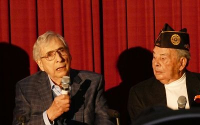 Mort Waitzman (left) and Bob Maran discuss their World War II experiences at Atlantic Station on Feb. 4. (Photo by Michael Jacobs)