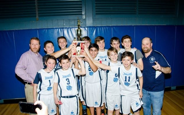 The AJA Jaguars celebrate their MAAC Division 2 middle school basketball championship Jan. 25. (Photo by Eli Gray)