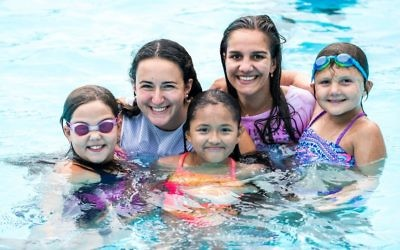 Counselors Emily, 25, and Sophie, 22, swim with campers Keira, 10, Genesis, 11, and Kaitlyn, 10, at Sunrise Day Camp-Long Island.