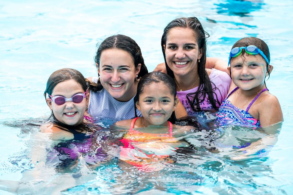 4cce66783554d Counselors Emily, 25, and Sophie, 22, swim with campers Keira, 10