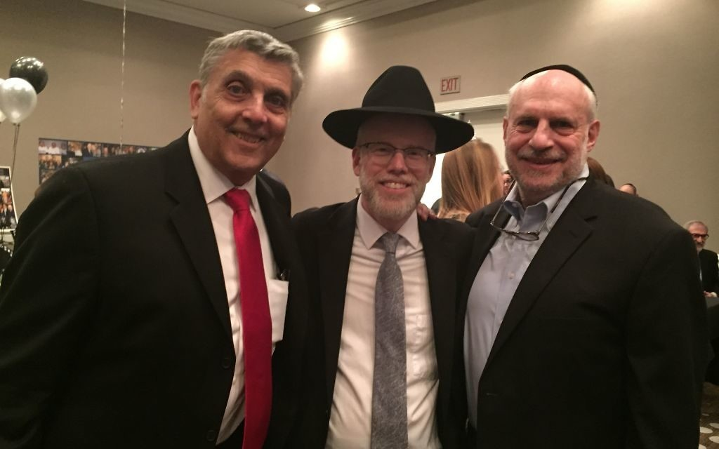 Chuck Lowenstein, Rabbi Shimon Wiggins and Harve Linder pose at the kollel celebration. (Photo by Marcia Caller Jaffe)