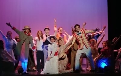 The ensemble accompanies Mary Poppins (Sara Goldberg) and Bert (Jordan Joel) for a jolly walk in the park to help Jane and Michael realize that sometimes their troubles are not as big as they seem. (Photo by Sarah Moosazadeh)