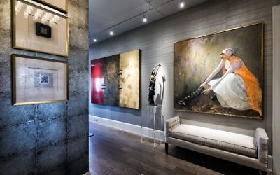 "The art in the entrance hallway includes a 90-by-66-inch, three-panel ""Flag"" from the Fay Gold Gallery, a bronze sculpture by local artist Tina Stern, and the painting ""Girl in the Boot"" by Dodie Petro."