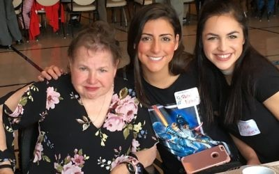 "Marla Rosenberg poses with her PALs, Rachel Nelkin and Dylan Oakes at the 2017 Special Seder at Shearith Israel. Oakes says their time together is ""incredibly rewarding"" and ""the favorite part of my week."""