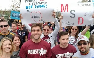 Marjory Stoneman Douglas alumni represent the school with banners and homemade signs.