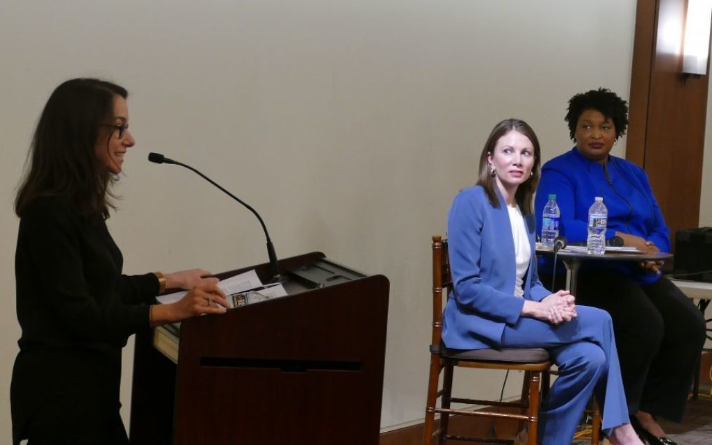 Stacey Evans and Stacey Abrams sport different shades of blue, which may or may not reflect differences in their political approaches, while listening to Valerie Habif open a Jewish Democratic Women's Salon forum in Sandy Springs in February.