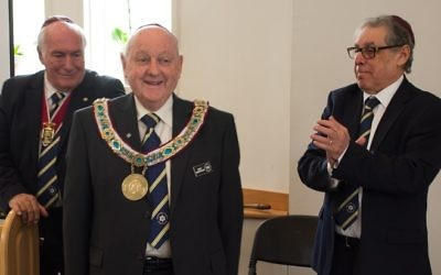 Worthy Brother Alan Rubenstein greets delegates at the 43rd biennial conference of the Hebrew Order of David International after being installed as grand president Sunday, March 18. Looking on are Worthy Brother Stan Klaff, the secretary of the Grand Lodge, and Michael Margolis, the immediate past president. Rubenstein, a resident of Dunwoody, is the first North American leader of worldwide HOD, a Jewish fraternal organization dedicated to Jewish community service. (Photo by Stan Schnitzer)