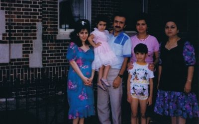 Nelly Iskhakova, Moshe Iskhakova with daughter Mariya in his arms, Mira and Mariya (the husband's cousins) and Mira's daughter Liza pose for a family photo.