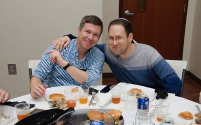 Young Israel's current president, Hillel Glazer (left), and its immediate past president, Davi Kutner, share a table at the Man Seder.