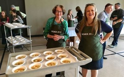 Judy Tager and Shearith Israel Executive Director Jodi Salomon are ready to serve matzah ball soup.