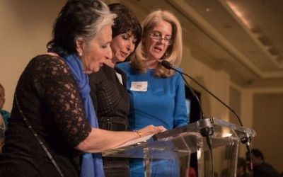 Atlanta Unity Seder co-chairs (from left) Merle Horwitz, Debbie Neese and Meg Heyer recite a Passover blessing.