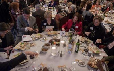 Sandy Springs Mayor Rusty Paul participates in the seder meal with members of Leadership Sandy Springs.