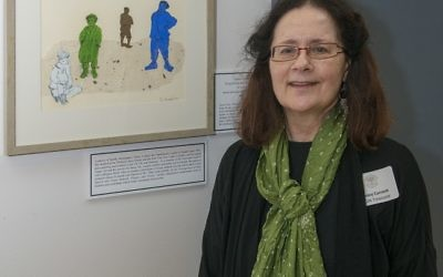 "Nancy Current of Seattle stands in front of her collage ""Teach Your Children,"" part of a series exploring hate speech in the Torah."