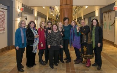 Kim Goodfriend (fifth from left), the Marcus JCC's assistant arts and culture director, is thanked by artists (from left) Diane Kowalski, Shoshannah Brombacher, Barbara Rucket, Flora Rosefsky, Laurie Wohl, Miriam Karp, Frann Addison, Lynette Joel and Nancy Current.