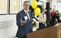 Norman Radow helps open the Kennesaw State exhibit honoring his father March 30. (Photo by David Caselli, Kennesaw State University)