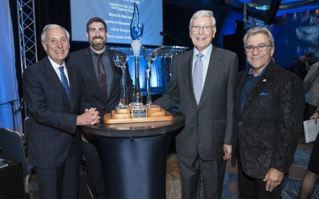 Bernie Marcus accepts the Visionary Award from the leadership of Hillels of Georgia — Rabbi Russ Shulkes, the executive director, and Michael Coles, the board president — and Hillel International President Eric Fingerhut (left).