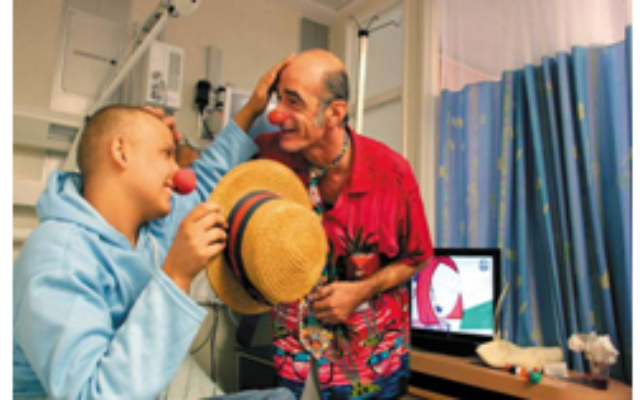 Chris, one of Hadassah's medical clowns, plays with a patient in the pediatric oncology department at Hadassah Ein Kerem.