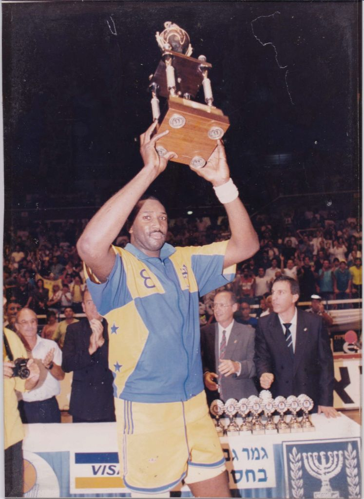 LaVon Mercer lifts a championship trophy for Maccabi Tel Aviv, which he led to six Israeli basketball league titles in seven seasons from 1988 to 1995.