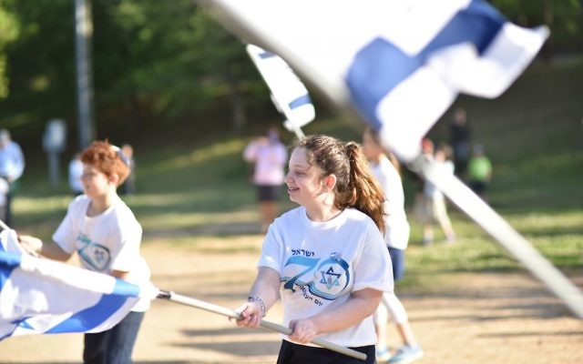 A flag show is one of the treats for the more than 500 people attending the Young Israel of Toco Hills barbecue at Mason Mill Park on April 19. (Photo by Beth Intro Photography)
