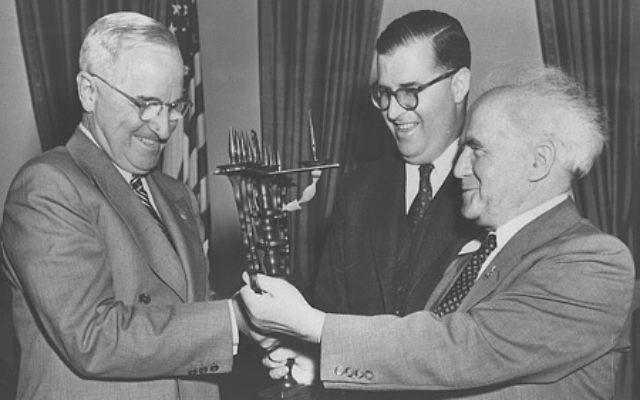 Prime Minister David Ben-Gurion and Ambassador Abba Eban present a menorah to President Harry Truman in 1951. (Photo by Fritz Cohen, Israeli Government Press Office)