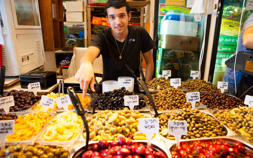 Outdoor markets such as Carmel in Tel Aviv attract tourists with a myriad of foods and spices.