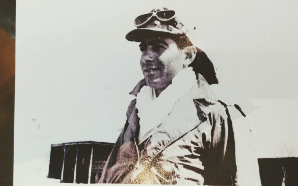 Chaim Avneri wears goggles to protect his eyes while driving a jeep. The soldiers did not have official uniforms at the time.