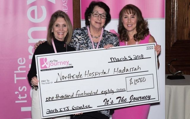 Joined by Northside nurse educator Susan Casella (left), Ellen Banov accepts the grant check from It's the Journey Executive Director Kimberly Goff (right).