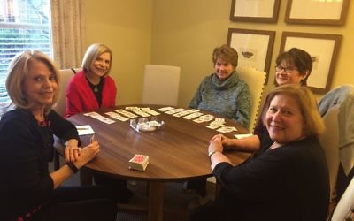 Audrey Mande, Arlyne Delman, Iris Wynne, Susan Kaye and Debbie Miller enjoy the challenge and the socializing that canasta provides.