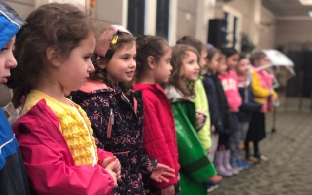 Beth Jacob pre-kindergartners sing for Holocaust survivors at Camp Europa on March 26.
