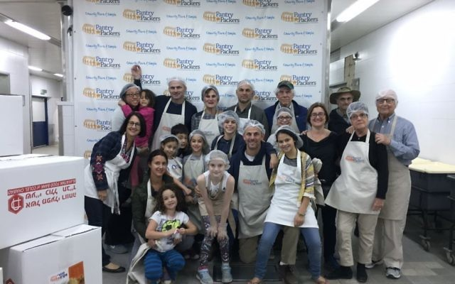 This is Lois Frank's 75th birthday celebration in Jerusalem. in 2016, when her entire family volunteered at a food bank, Pantry Packers.