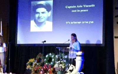 Tali Barel speaks at the Yom HaZikaron commemoration April 17 at The Temple.