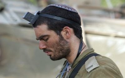 Rabbi Arnold Goodman sent this photo of an IDF soldier davening as an example of Israel's mix of tradition and modernity.