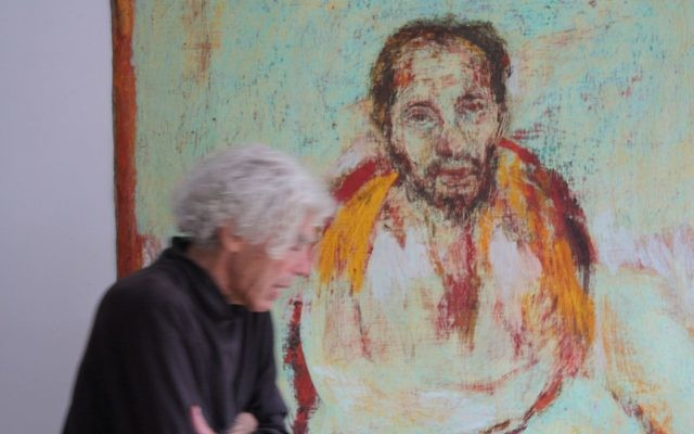 Artist Richard Rappaport stands with his painting of Swami Muktananda. (Photo by River Gibeaut)