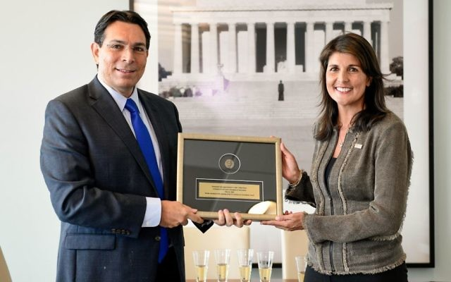 """Israel's ambassador to the United Nations, Danny Danon, meets with his U.S. counterpart, Nikki Haley, in honor of the opening of the U.S. Embassy in Jerusalem on Monday, May 14. He presented her with a coin from the Great Jewish Revolt of 68 C.E. with a personal dedication: """"This is a historic day for Israel and the United States. I thank you, Ambassador Haley, for your strong support of this great move."""" (Photo by Shahar Azran)"""