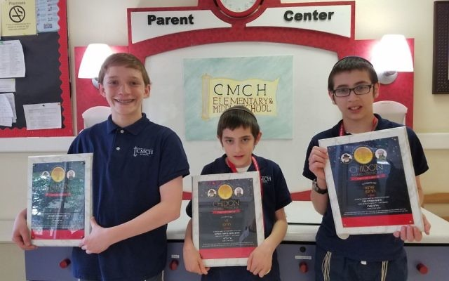 (From left) Aaron Linder, Levi Charytan and Shraga Charytan from Chaya Mushka Children's House hold their Chidon plaques. (CMCH photo)