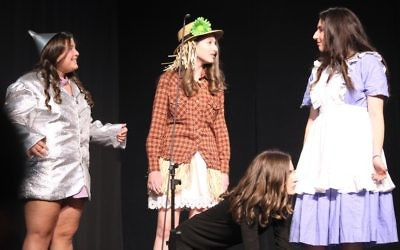 "(From left) Mollie Meyerowitz, Rebecca Kann, Andrea Zaglin and Elana Katz perform a skit based on ""The Wizard of Oz"" to represent the heart, brains and courage of Epstein graduates."