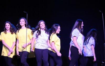 (From left) Lulu Rosenberg, Reagan Lapes, Kira Berzack, Tamar Guggenheim and Marissa Goodman perform a moving modern Israeli dance at their graduation.