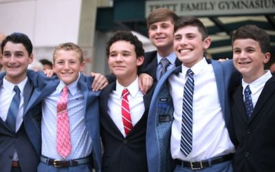 (From left) Asher Force, Mo Zibitt, Spencer Dickson, David Leavitt, Aaron Bock and Jordan Tovin gather for a moment of camaraderie and a final picture the night of their graduation.