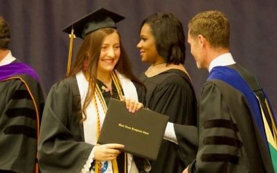 Maqueline Weiss receives her diploma at Mount Vernon Presbyterian School's graduation May 19.