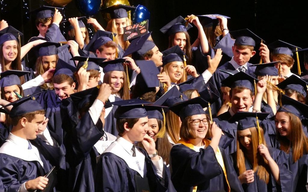 Members of the Weber Class of 2018 flip their tassels to the left, indicating that they are graduates.