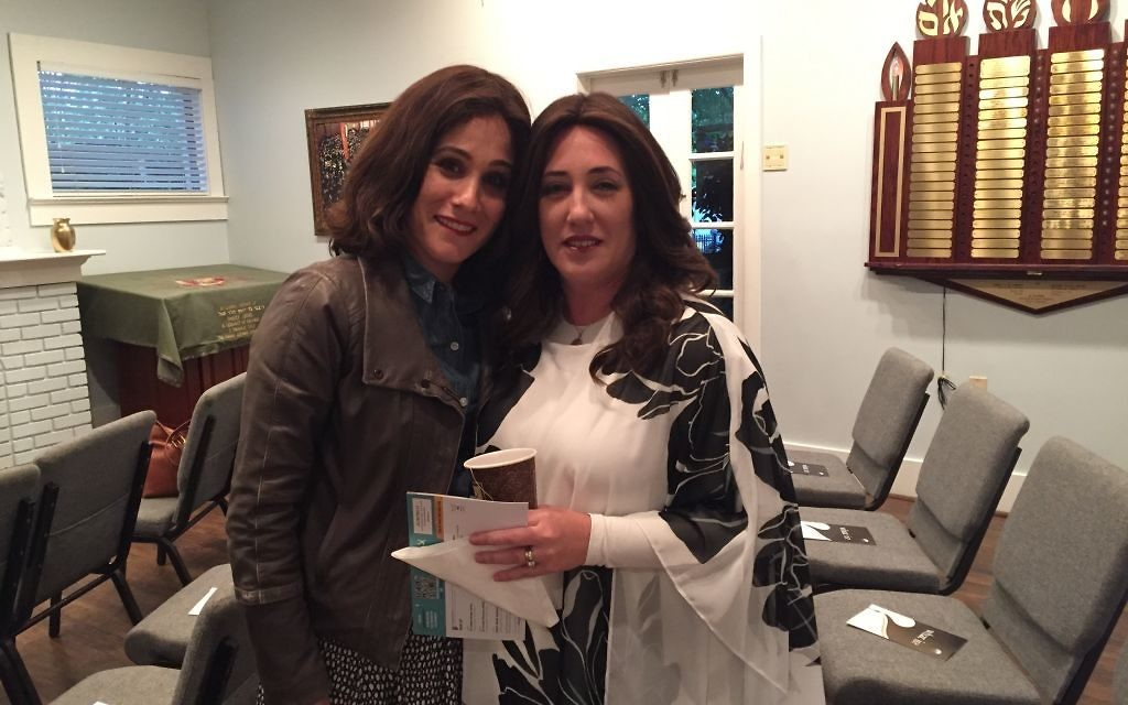 Dena Schusterman (left) welcomes Dina Hurwitz to Intown Jewish Academy on April 24. (Photo by Marcia Caller Jaffe)