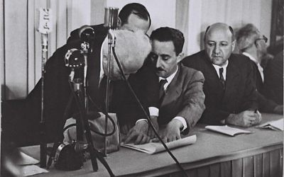 (From left) David Ben-Gurion, Moshe Shertok and Eliezer Kaplan participate in the signing of Israel's Declaration of Independence. (National Photo Collection of Israel)