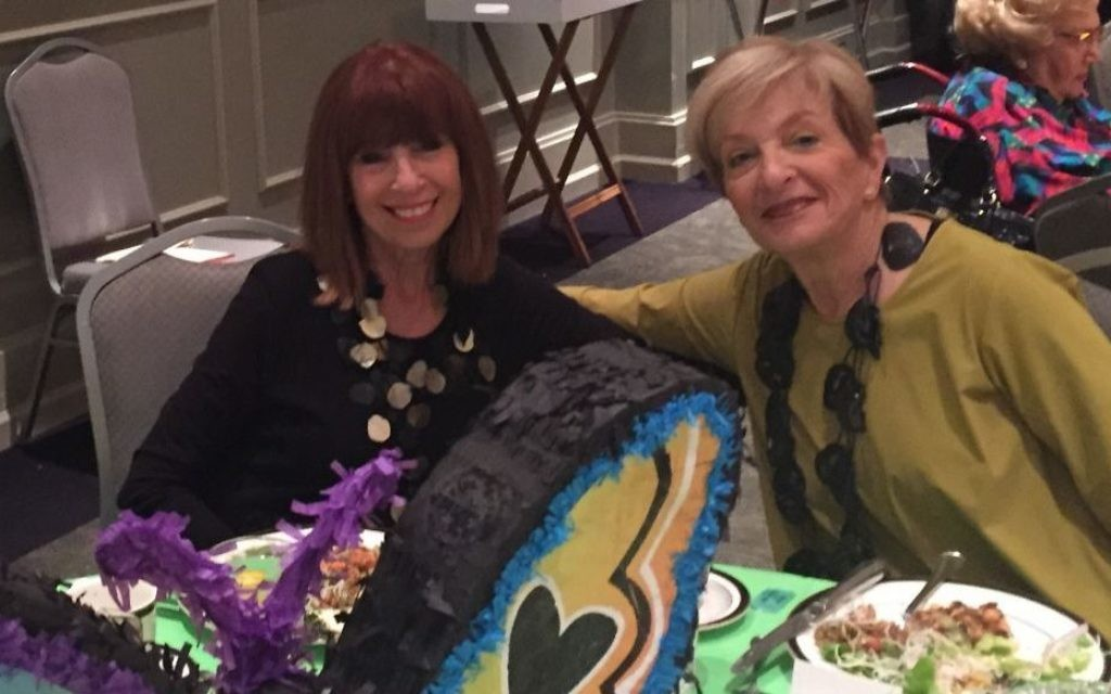 Auxiliary event co-chairs Fran Scher and Ann Kay enjoy the piñata butterfly décor. Not pictured is co-chair Sherry Habif. (Photo by Marcia Caller Jaffe)