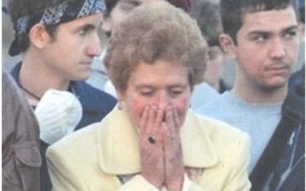 Jackie Gothard weeps at the burial of Congregation Beth Israel Torah scrolls in 2005.