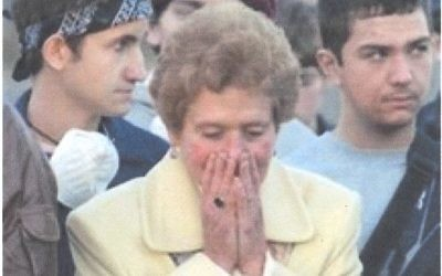 Jackie Gothard weeps at the burial of Congregation Beth Israel Torah scrolls in 2005.