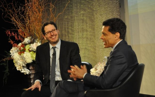 David Lubell (left), founder of Decatur-based Welcoming America, speaks with CNN's Fareed Zakaria during the Charles Bronfman Prize ceremony April 30 in New York.