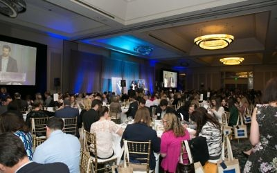 Nearly 600 people pack the Grand Hyatt ballroom for the Community of Caring luncheon.