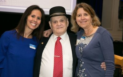 Clinicians Anat Granath (left) and Amy Neuman escort Holocaust survivor Leon Asner, who shared his journey with JF&CS.